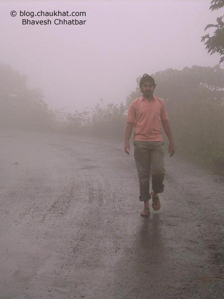 Bhavesh walking in the monsoon-clouds-filled roads of the beautiful land of the forest of Bhimashankar