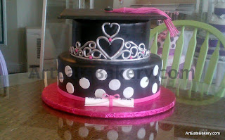 Custom two tier black, white and silver fondant graduation cake with dots and custom silver curlicue princess crown design with pink gems and edible graduation cap and scroll