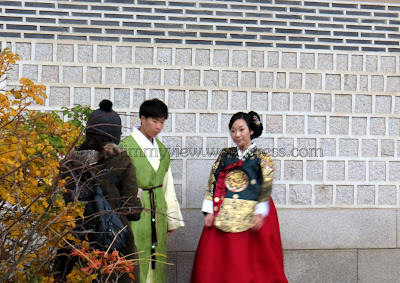 Couple having their wedding photos taken in traditional costumes in the palace!!