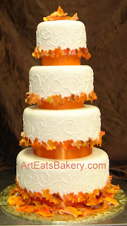 Four tier custom designed fall leaves wedding cake with curlicue piping