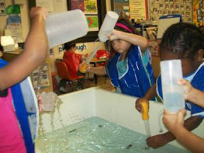Children use a variety of open-ended materials to explore water.