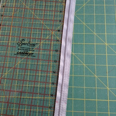 Tutorial for adding a zipper tab to each end of a zip.