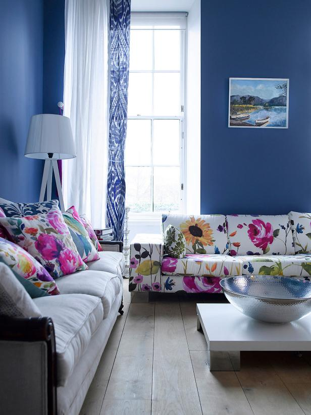 Blue Living Space With Floral Sofa and Pillows