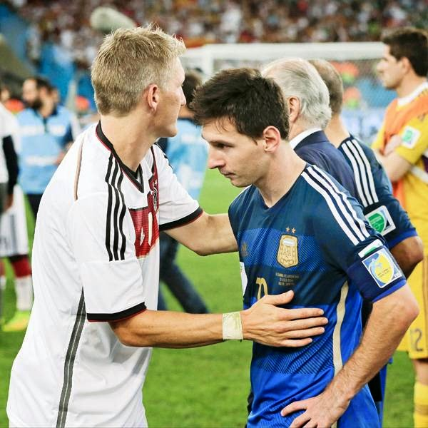 Germany's Bastian Schweinsteiger, left, consoles Argentina's Lionel Messi after the World Cup final soccer match between Germany and Argentina at the Maracana Stadium, in Rio de Janeiro, Brazil, on July 13, 2014.