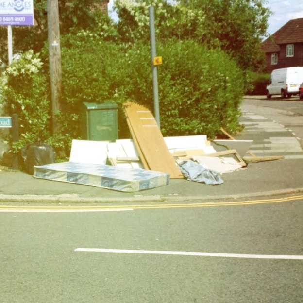Fly Tipped Dangerous junk on the corner of Geraint and Launcelot in Downham, Lewisham / Bromley.
