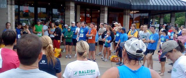 Raleigh 8000 runners watching award ceremony
