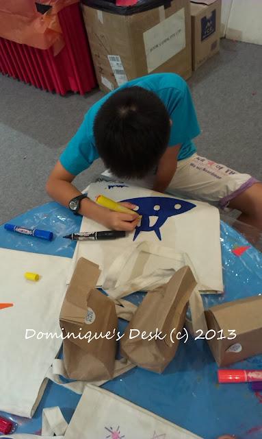 Monkey boy decorating his bag