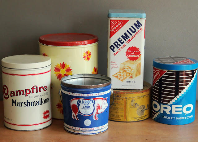 Assorted large tins available for rent from www.momentarilyyours.com, $4.00 each.