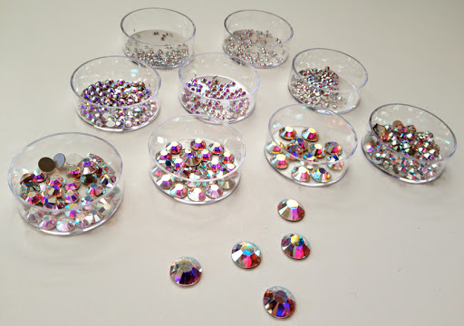 For my silver egg, I chose Swarovski crystal rhinestones in aurora borealis. I used a total of 10 different sizes ranging from extra small to medium.