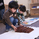 Montessori boy in Irvine working with broad stair.