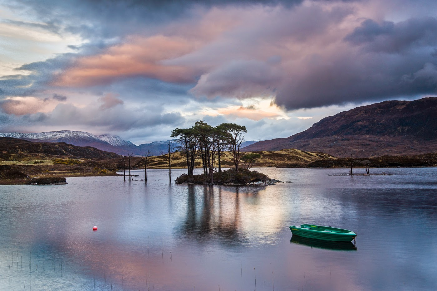 With this image made during a short but beautifully colored sunset by the Loch Assynt…