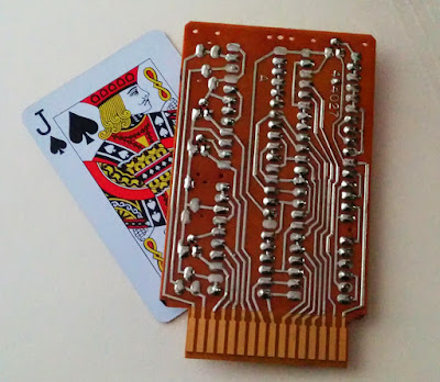 An IBM SMS card (type DGU) with a playing card for scale.
