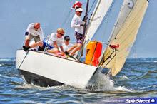 J/24 one-design sailboat- team sailing off Annapolis, MD