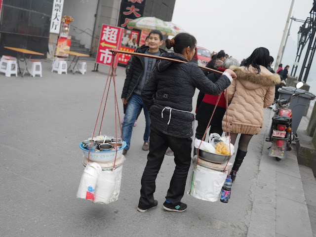 woman carrying supplies to make food