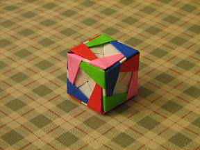 "Cube from 12 Snow-Capped Sonobe 1 units from Meenakshi Mukerji's ""Marvelous Modular Origami""."
