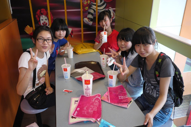 Five students in Zigong posing for a photo in a McDonalds