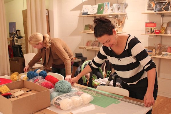 amy bengtson and chika eustace of velouria boutique cutting yarn for assemble crafting kits at party