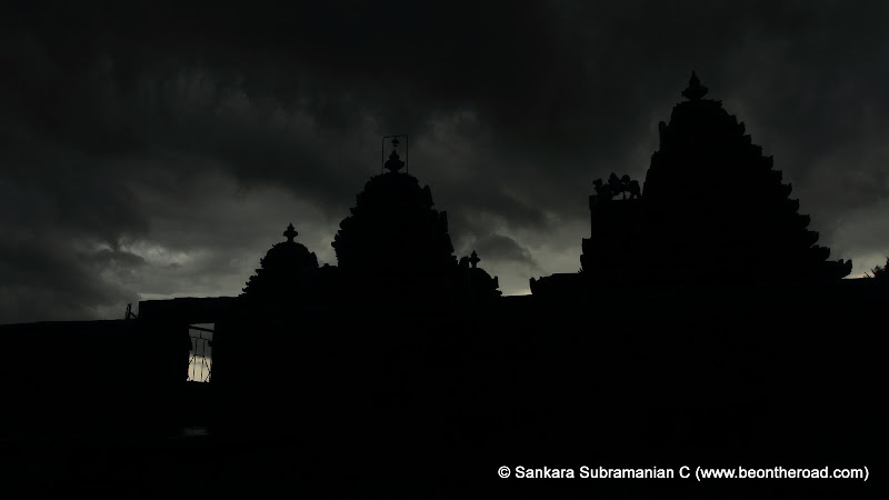 Silhouette of the Lakshmi Devi Temple against the dark monsoon skies at Doddagaddavalli