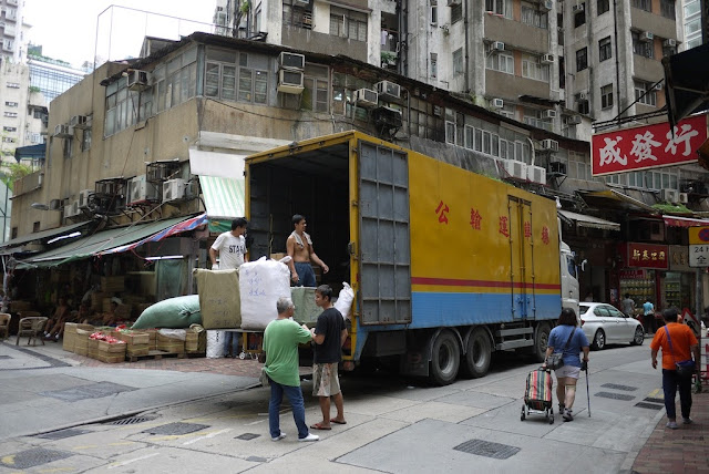 men loading a truck in Hong Kong