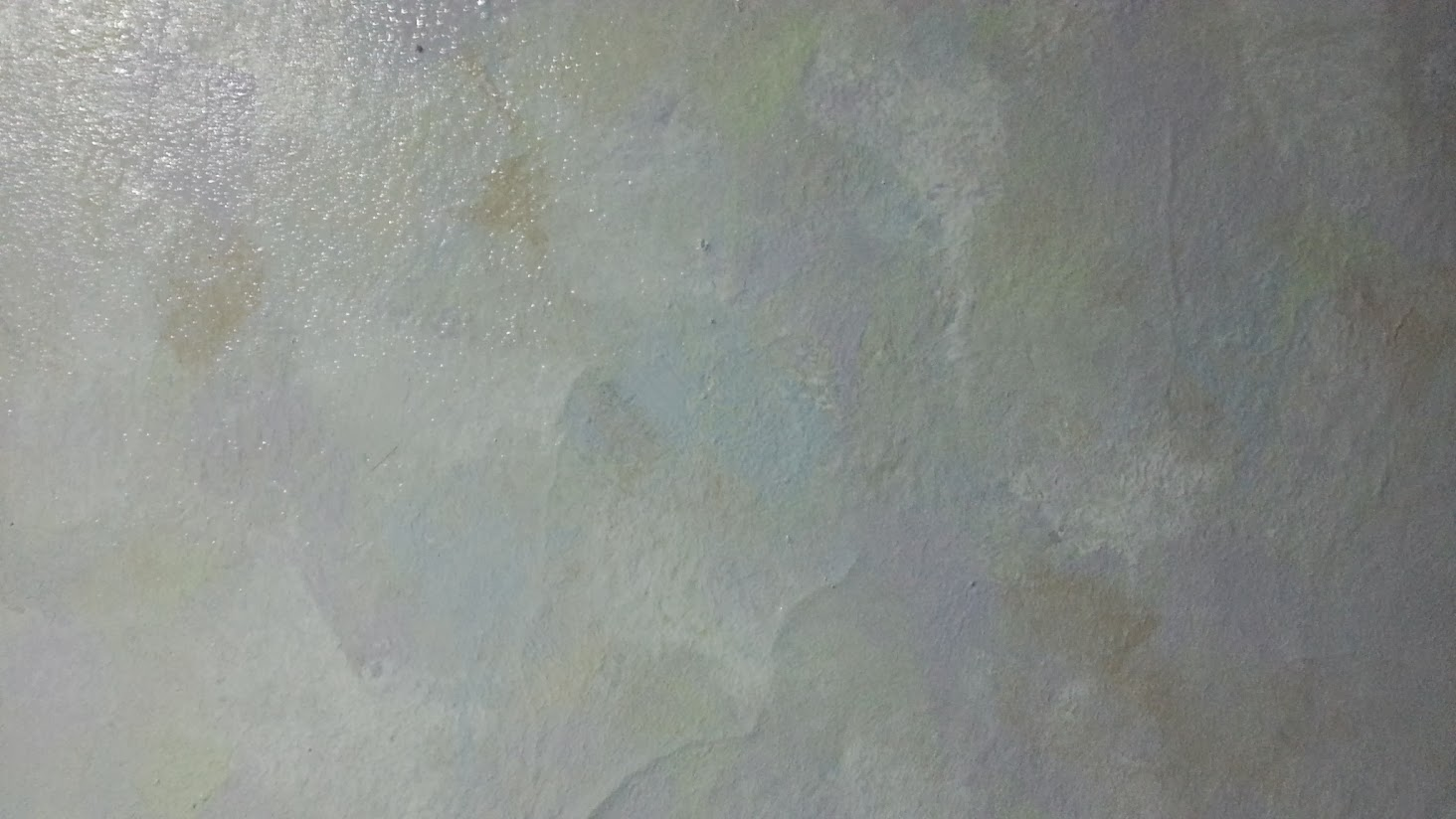Multi-pastel paint smudged together on the wall