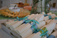 These napkins wrapped with turquoise ribbon add to the party's theme.