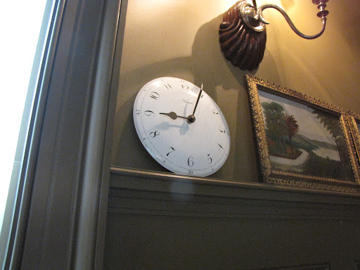 I personally loved this clock, and it got me thinking about a simple clock idea for a kid's room ...