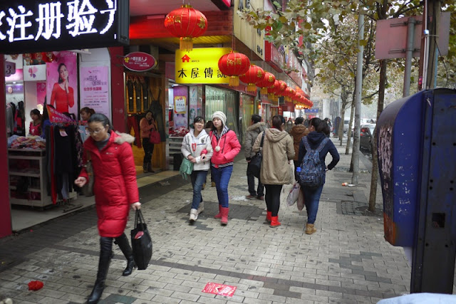 young women walking on sidewalk in Hengyang, Hunan province, China