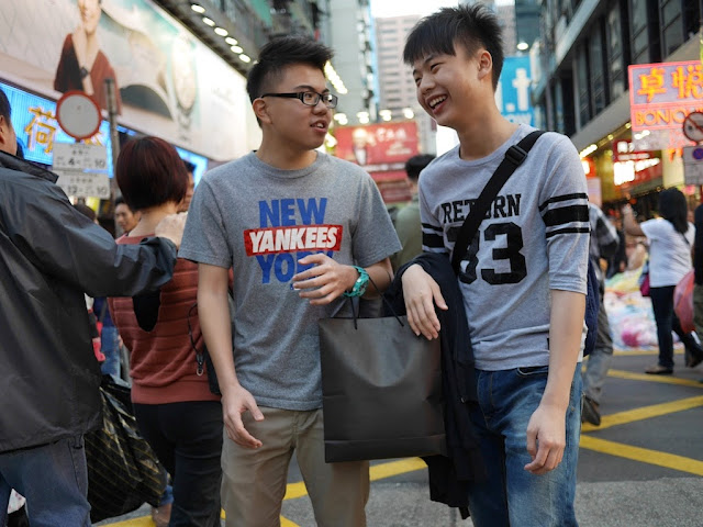 two young men talking at Sai Yeung Choi Street South