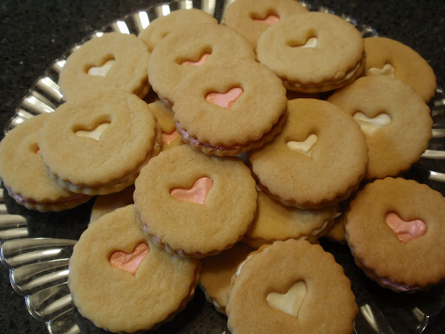 Valentine's Day heart linzer cookies with pink and white frosting