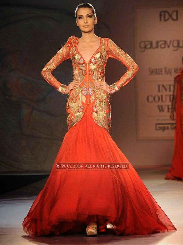 Sanea walks the ramp for designer Gaurab Gupta on Day 3 of India Couture Week, 2014, held at Taj Palace hotel, New Delhi.<br />