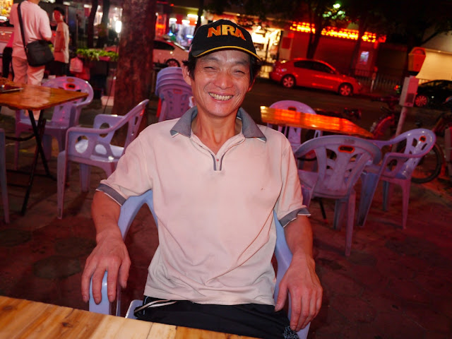 man in Zhuhai, China, wearing a baseball cap with the word NRA