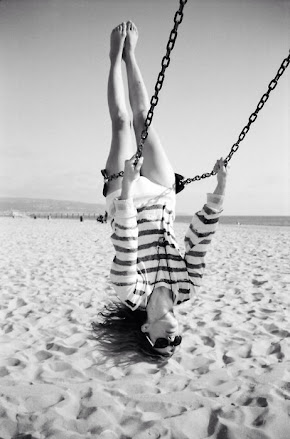 Stripe top girl on swing