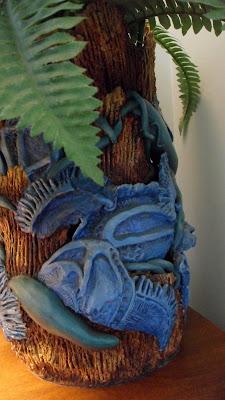 Ceramic organic pot, handmade pot. Close up of the turquoise leaf shapes