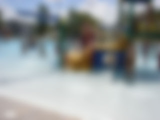 same picture of the aquatic center, all blurred out