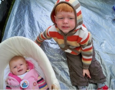 Our top tips on how to camp with a baby and keep them warm at night.