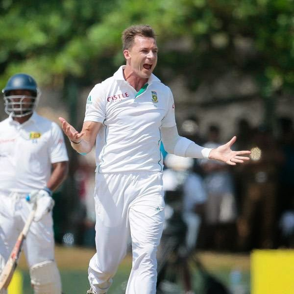 South African bowler Dale Steyn, right, celebrates taking the wicket of Sri Lankan batsman Kaushal Silva as non striker Kumar Sangakkara watches during the fifth day of the first test cricket match in Galle, Sri Lanka, Sunday, July 20, 2014.