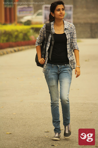 Camisole layered with buttton down shirt, jeans and a pair or sneakers.