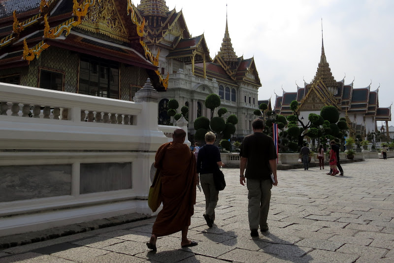 Monk walking past Grand Palace