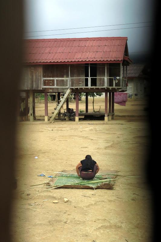 Woman weaving a bamboo mat