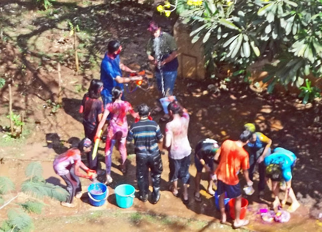 playing with coloured water during Holi