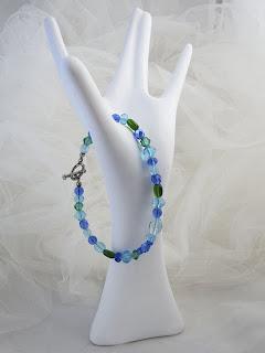 "Glass & crystal beads 8""  $12"