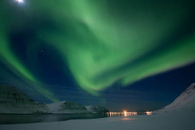 swirls of the northern lights over a lake