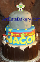 Three tier custom fondant kid's Toy Story birrthday cake with moon, stars and