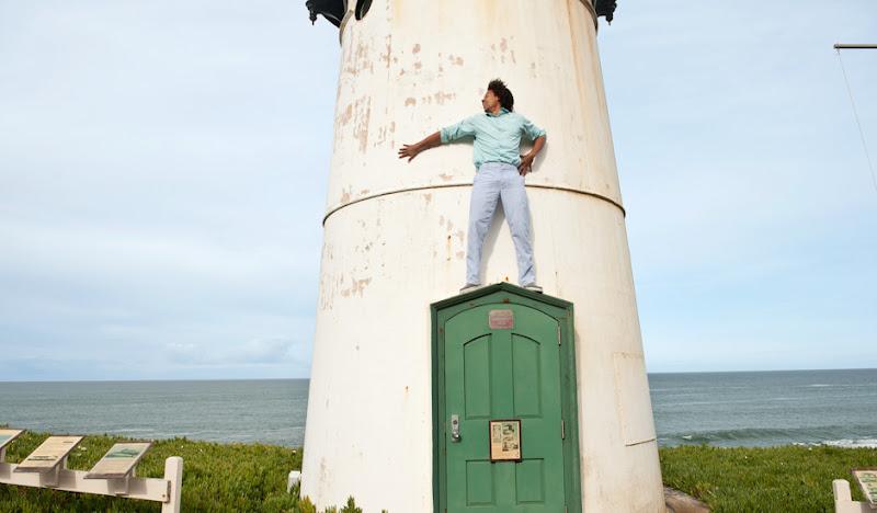 Blue seersucker pants standing atop a lighthouse door