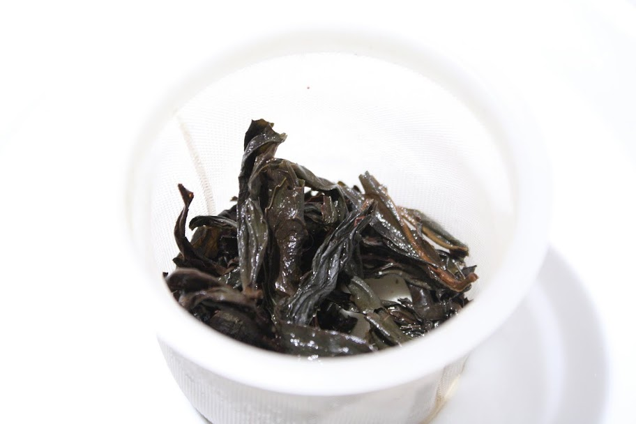 steeped tea leaves and basket