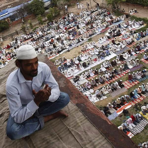 Muslims offer last Friday prayers at the Jama Masjid (Grand Mosque) ahead of Eid-al-Fitr, in the old quarters of Delhi.