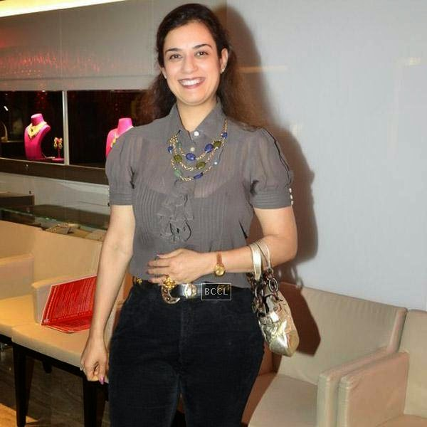 A guest smiles for the lens during Nisha Jamwal and Veda Raheja's high tea party, held at Zoya on July 24, 2014.(Pic: Viral Bhayani)