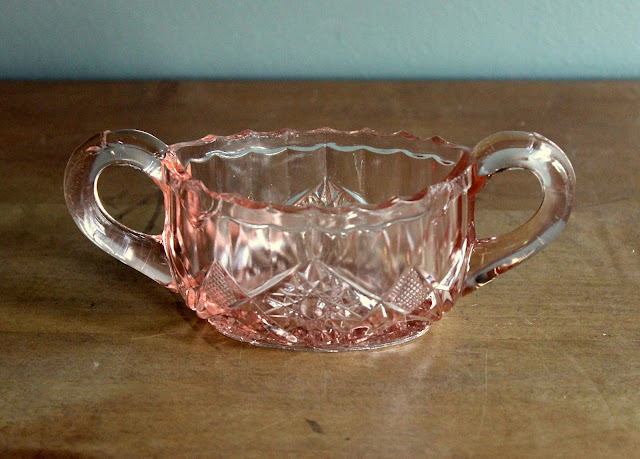 Pink depression glass sugar packet holder available for rent from www.momentarilyyours.com, $0.50.