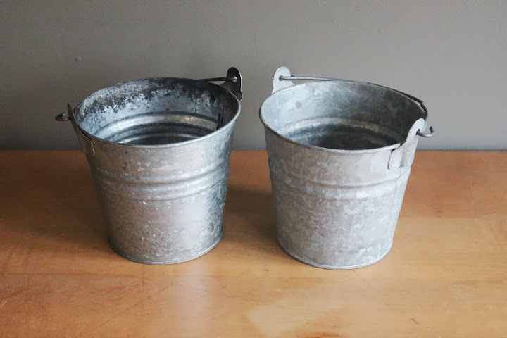 Small metal pails available for rent from www.momentarilyyours.com, $1 each.