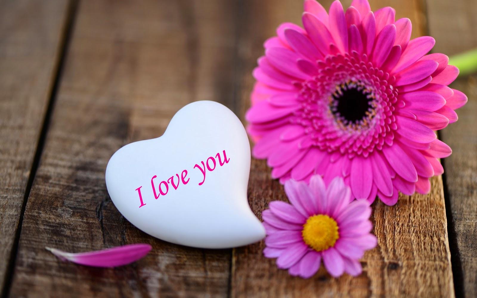 Liefdes achtergronden bureaublad achtergronden leuke houten liefdes achtergrond met roze bloemen en een wit hartje met de tekst i love you voltagebd Choice Image